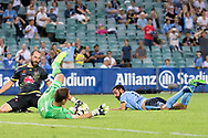 February 8, 2017: Sydney FC forward Alex BROSQUE (captain) (14) nearly gets the ball past Wellington Phoenix Goalkeeper Glen MOSS (1) at Round 19 of the 2017 Hyundai A-League match, between Sydney FC and Wellington Phoenix played at Allianz Stadium in Sydney. Sydney FC won the game 3-1.