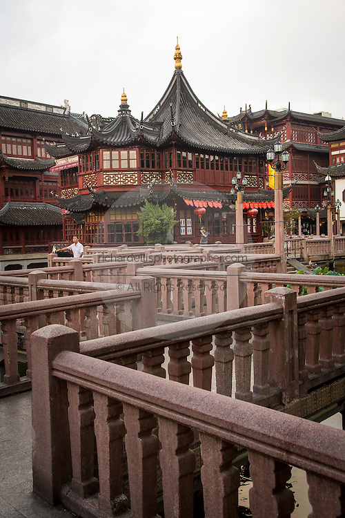 The zigzag bridge leading to the Huxinting Teahouse in Yu Yuan Gardens Shanghai, China