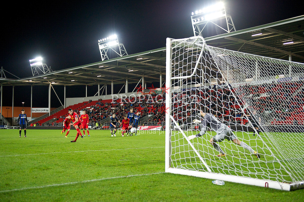 ST HELENS, ENGLAND - Tuesday, January 8, 2013: Liverpool's captain Conor Coady scores the opening goal from the penalty spot past Inter Milan's goalkeeper Dawid Smug during the NextGen Series Group 5 match at Langtree Park. (Pic by Chris Brunskill/Propaganda)