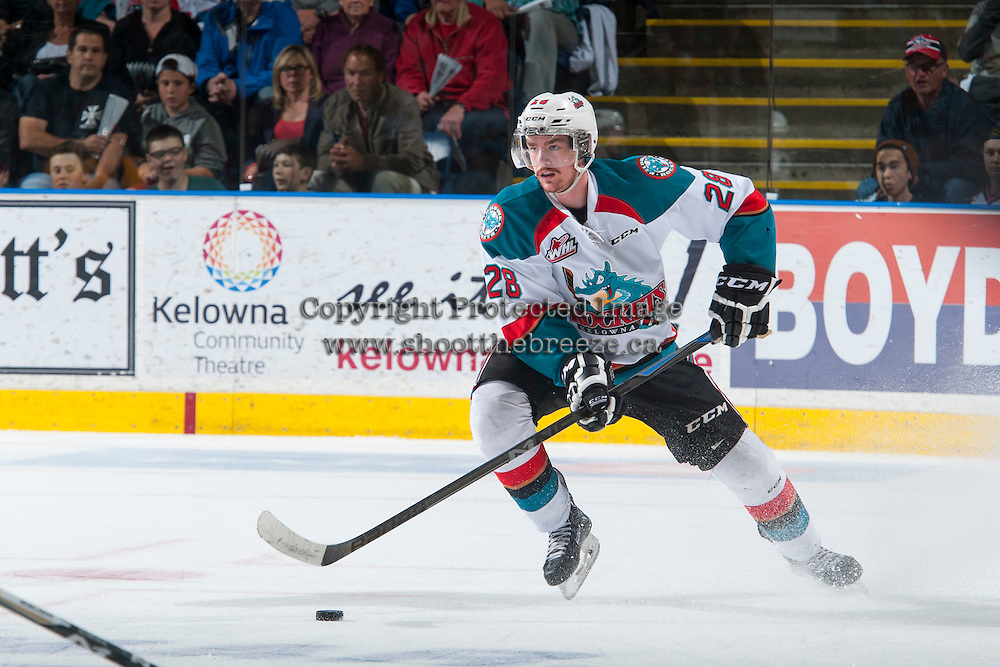 KELOWNA, CANADA - MAY 13: Joe Gatenby #28 of Kelowna Rockets skates with the puck against the Brandon Wheat Kings on May 13, 2015 during game 4 of the WHL final series at Prospera Place in Kelowna, British Columbia, Canada.  (Photo by Marissa Baecker/Shoot the Breeze)  *** Local Caption *** Joe Gatenby;