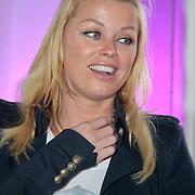 NLD/Amsterdam/20110521 - Amsterdam fashion Gala 2011, Bridget Maasland ontvangt een award voor haar stichting Dutch Puppies
