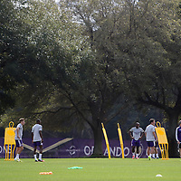Players are seen on the pitch with head coach Adrien Heath during the first day of MLS soccer team practice for the Orlando City Soccer Club at Sylvan Lake Park on Friday, January 23, 2015 in Sanford,Florida. (AP Photo/Alex Menendez)
