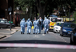 © Licensed to London News Pictures. 12/07/2020. London, UK. Police forensics working at the scene of a murder on the Black Prince Estate in Kennington South London in which a man, believed to be in his 30s, was stabbed to death late last night . Photo credit: Ben Cawthra/LNP
