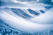 Mountain ravine filled with frosty clouds