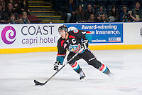 KELOWNA, CANADA - NOVEMBER 6:  Madison Bowey #4 of the Kelowna Rockets moves the puck up the ice against the Red Deer Rebels on NOVEMBER 6, 2013 at Prospera Place in Kelowna, British Columbia, Canada.   (Photo by Marissa Baecker/Shoot the Breeze)  ***  Local Caption  ***