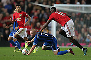 Rochdale's Stephen Dooley pushed by Manchester United's Paul Pogba during the EFL Cup match between Manchester United and Rochdale at Old Trafford, Manchester, England on 25 September 2019.