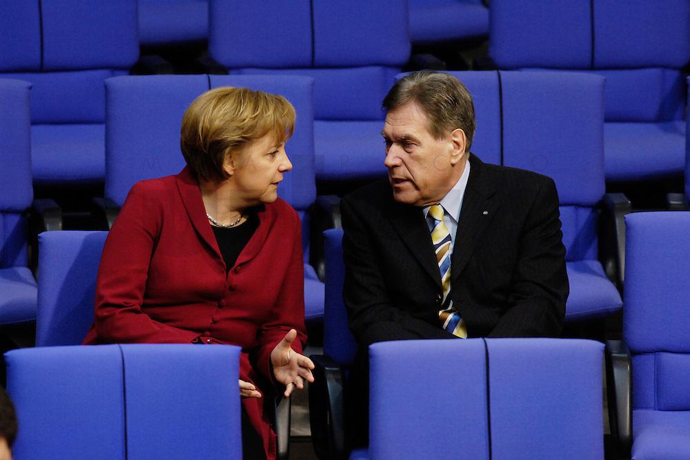 17 MAR 2006, BERLIN/GERMANY:<br /> Angela Merkel (L), CDU, Bundeskanzlerin, und Michael Glos (R), CSU, Bundeswirtschaftsminister, im Gespraech, waehrend der Bundestagsdebatte, Regierungserklaerung zum Europaeischen Rat, Plenum, Deutscher Bundestag<br /> IMAGE: 20060317-01-025<br /> KEYWORDS: Gespr&auml;ch