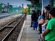 31 MAY 2017 - CHACHOENGSAO, THAILAND:  People wait for a Bangkok bound train to come into the train station in Chachoengsao, a provincial town about 50 miles and about an hour by train from Bangkok. The train from Chachoengsao to Bangkok takes a little over an hour but traffic on the roads is so bad that the same drive can take two to three hours. Thousands of Thais live outside of Bangkok and commute into the city for work on trains, busses and boats.      PHOTO BY JACK KURTZ