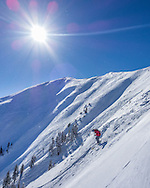 A skier drops into the Highland Bowl in Aspen, Colorado.