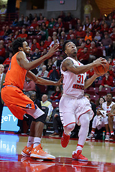10 December 2016:  Javaka Thompson(31) darts to the hoop passing Malik London during an NCAA  mens basketball game between the UT Martin Skyhawks and the Illinois State Redbirds in a non-conference game at Redbird Arena, Normal IL