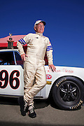 Image of Bruce O'Neil and his 1965 Porsche 911 Trans Am racecar at Sonoma Raceway, California, America west coast, model and property released