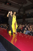 Naomi Campbell and Julian Macdonald. Julian Macdonald  fashion show, Le Meridien Grosvenor House. After party, Il Bottaccio, Grosvenor Place. London. 14 September 2002. © Copyright Photograph by Dafydd Jones 66 Stockwell Park Rd. London SW9 0DA Tel 020 7733 0108 www.dafjones.com