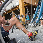 A mechanic inflates a bicycle tire. Sunday River, ME. The 2007 Trek Across Maine, an annual project of the American Lung Association of Maine (ALAM).