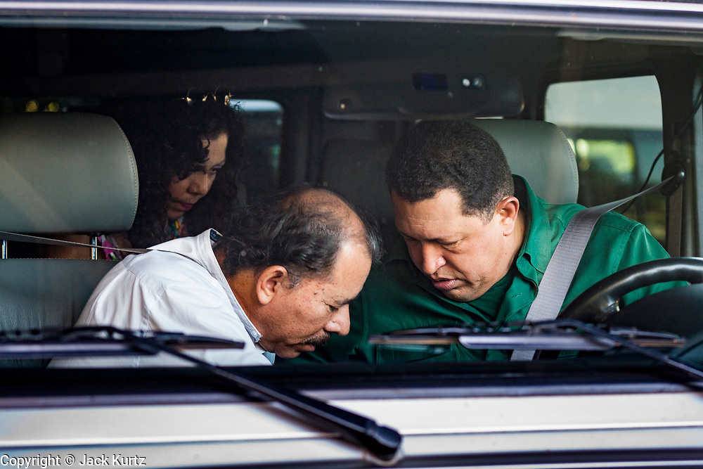 12 JANUARY 2007 - MANAGUA, NICARAGUA: DANIEL ORTEGA, left, President of Nicaragua, talks to HUGO CHAVEZ, President of Venezuela when Chavez drove them to the airport in Managua before Chavez left Nicaragua to return to Venezuela. Chavez has promised massive amounts of aid  for Nicaragua including free and discounted oil and portable electric generating stations. Nicaragua is the second poorest country in the western hemisphere.  Photo by Jack Kurtz