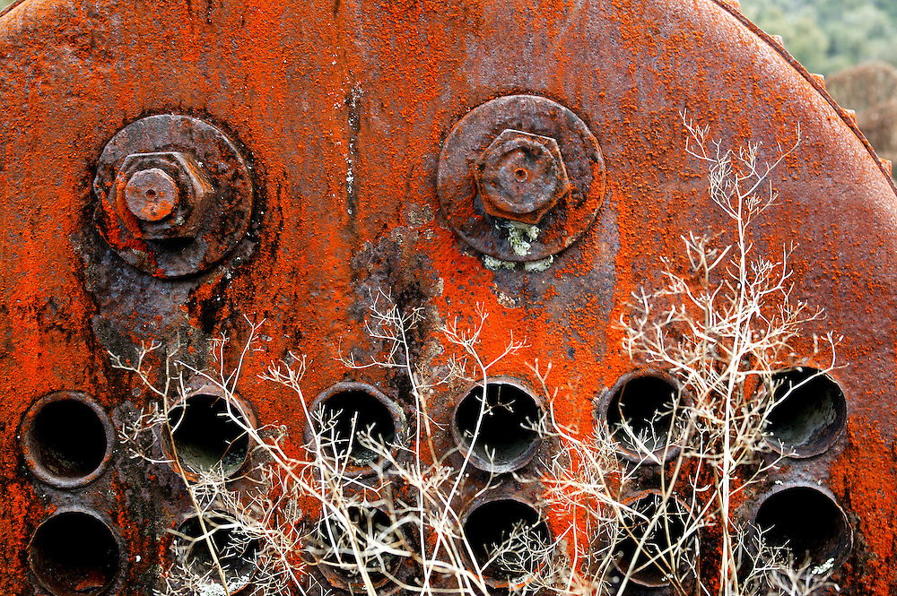 Rust covers the remains of an old boiler left to rust beside the road through the Moki Forest in East Taranaki, New Zealand, February 09, 2006. The boiler was used to drive saws during the early days of native logging in the area. Credit:SNPA / Rob Tucker