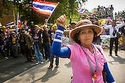 18 FEBRUARY 2014 - BANGKOK, THAILAND: Anti-government protestors in Bangkok wait to confront Thai riot police near Government House. Anti-government protestors aligned with Suthep Thaugsuban and the People's Democratic Reform Committee (PDRC) clashed with police Tuesday. Protestors opened fire on police with at rifles and handguns. Police returned fire with live ammunition and rubber bullets. The Bangkok Metropolitan Administration's Erawan Emergency Medical Centre reported that three civilians and a policeman were killed and 64 others were injured in the clashes between police and protesters.    PHOTO BY JACK KURTZ