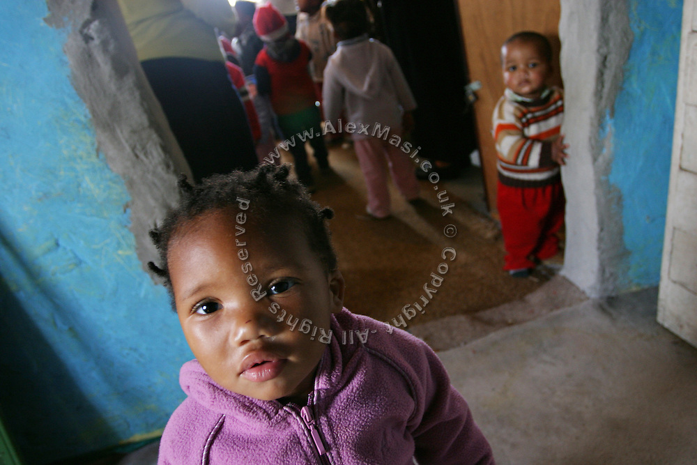 Children at a creche in Khayelitsha township in Cape Town, where over a million people live in the extreme poverty..