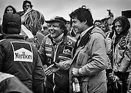 Newly-crowned two-time 1977 World Driving Champion Niki Lauda greets great friend James Hunt who had just won the 1977 United States Grand Prix driving for McLaren. <br />