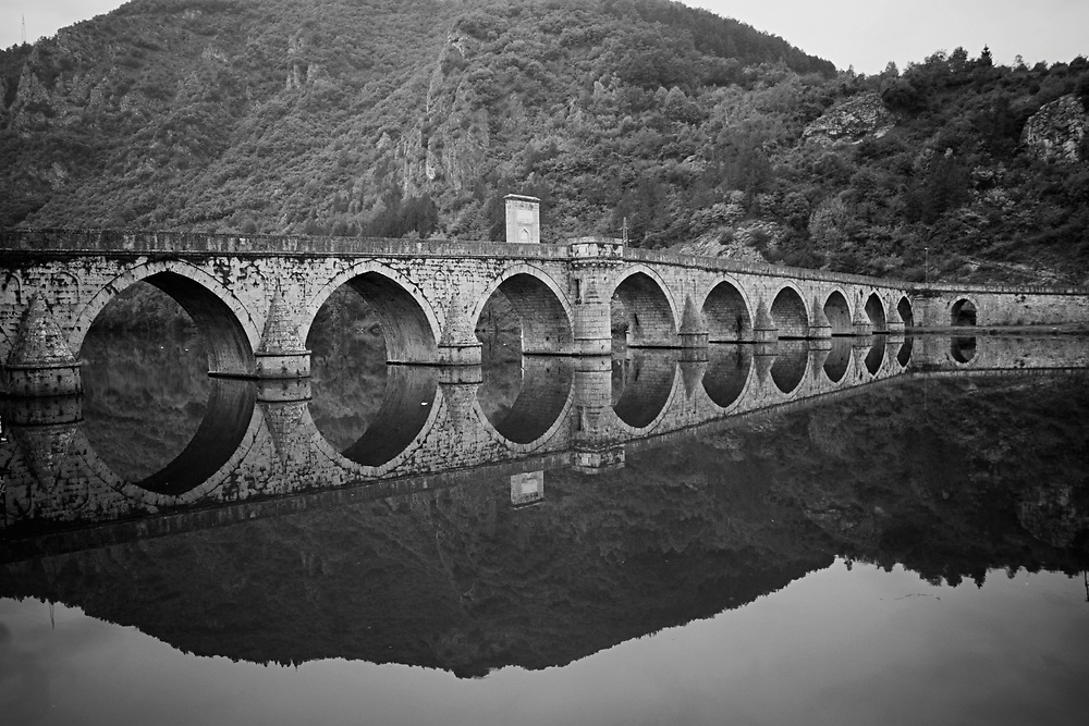 BiH, Visegrad, 2009. Ottoman bridge over River Drina in Visegrad. Each May 26, hundreds of Bosnian Muslims made an emotional visit to the bridge to remember the killing there of 3,000 relatives and friends by Bosnian Serb and Serbian paramilitaries at the outbreak of Bosnia's 1992-95 war