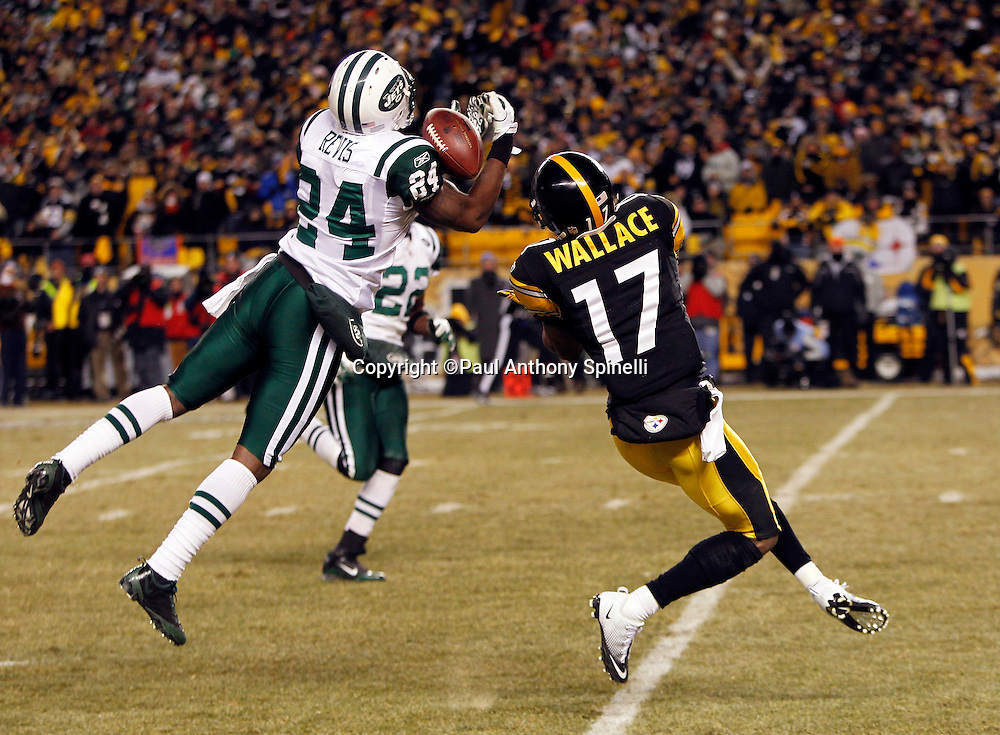 New York Jets cornerback Darrelle Revis (24) dives and nearly intercepts a deep pass intended for Pittsburgh Steelers wide receiver Mike Wallace (17) during the second quarter of the NFL 2011 AFC Championship playoff football game against the Pittsburgh Steelers on Sunday, January 23, 2011 in Pittsburgh, Pennsylvania. The Steelers won the game 24-19. (©Paul Anthony Spinelli)