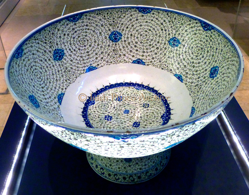 Basin with 'Golden Horn' Design, Turkey, probably Iznik.  About 1545.  This basin is decorated with tight concentric scrolls in black, which bear tiny leaves and flowers.  Design named 'Golden Horn' because examples excavated near the inlet in Istanbul known as the Golden Horn.