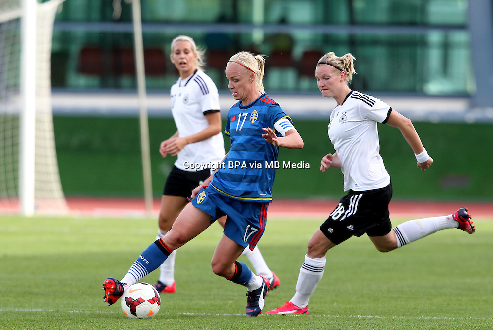 Fifa Womans World Cup Canada 2015 - Preview //<br /> Algarve Cup 2015 Tournament ( Vila Real San Antonio Sport Complex - Portugal ) - <br /> Germany vs Sweden 2-4   -  Caroline Seger of Sweden (L) , challenges with Alexandra Popp of Germany (R)