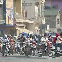 Jan 3, 2013 - Motorcycle drivers use masks to protect against smog, which do little to filter out harmful particles and gases in air pollution, as they navigate traffic through the Cambodian capital city of Phnom Penh.<br /> <br /> Story Summary: Amidst the feverish pace of Phnom Penh&rsquo; city streets, a workhorse of transportation for people and goods emerges: Bicycles, motorcycles, Mopeds, motodups and Tuk Tuks roam in place of cars and trucks. Almost 90 percent of the vehicles roaming the Cambodian capital of almost two million people choose these for getting about. Congestion and environment both benefit from the small size and small engines. Business is booming in the movement of goods and and another one million annual tourists in Cambodia&rsquo;s moto culture.