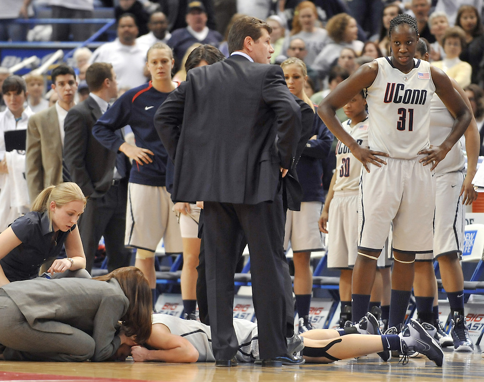 Connecticut coach Geno Auriemma and players stand near Caroline Doty after she was took an elbow to the head during the second half against Notre Dame in an NCAA college basketball game in the semifinals of the Big East tournament in Hartford, Conn., Monday, March 8, 2010. Connecticut won 59-44.  (AP Photo/Jessica Hill)