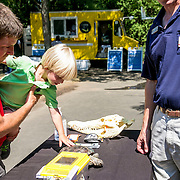 August 24, 2016, New Haven, Connecticut: <br /> Fans look at the Beardsley Zoo booth during Day 6 of the 2016 Connecticut Open at the Yale University Tennis Center on Wednesday, August  24, 2016 in New Haven, Connecticut. <br /> (Photo by Billie Weiss/Connecticut Open)