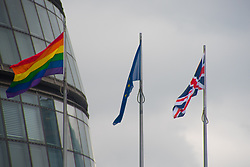 June 28, 2017 - London, United Kingdom - The Rainbow flag waves outside the City Hall, with the EU and Union flags, London on June 28, 2017. The flag has been put to celebrate Pride in London, the annual LGBT pride festival and parade held each summer in London. (Credit Image: © Alberto Pezzali/NurPhoto via ZUMA Press)