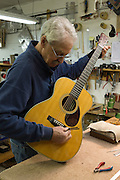 Tuning a 1937 Martin OM28 before shipping back to customer. Repairs included a fret job, new nut and bridge, and internal upgrades that dramatically improved the sustain.