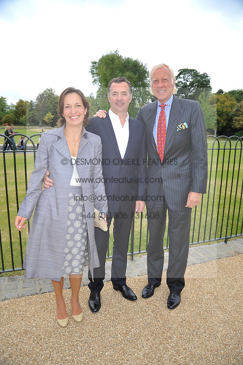 Left to right, artist SIMON GUDGEON, his wife MONIQUE and TODD RUPERT at the unveiling of 'Isis' a sculpture by Simon Gudgeon hosted by the Royal Parks Foundation and the Halcyon Gallery by the banks of The Serpentine, Hyde Park, London on 7th September 2009.