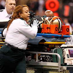December 12, 2010; New Orleans, LA, USA; New Orleans Saints kick returner Courtney Roby (15) is taken off the field on a stretcher after suffering an injury while returning a kickoff during the second quarter against the St. Louis Rams at the Louisiana Superdome. Mandatory Credit: Derick E. Hingle-US PRESSWIRE