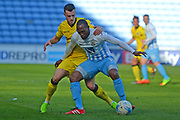 Bristol Rovers midfielder Billy Bodin (23) holds up Coventry City midfielder Kyel Reid (11) 0-0 during the EFL Sky Bet League 1 match between Coventry City and Bristol Rovers at the Ricoh Arena, Coventry, England on 25 March 2017. Photo by Alan Franklin.