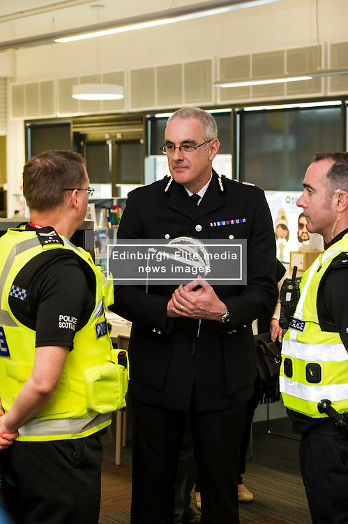 Pictured: Chief Constable Phil Gormley chatted to Sargant Kevin Smith and Chief Inspector Kevin McLean<br /> Police Scotland Chief Constable Phil Gormley unveiled details of the 'Your View Counts' exercise, which will help shape policing priorities throughout the country in Edinburgh today. <br /> Ger Harley | EEm 7 April 2016
