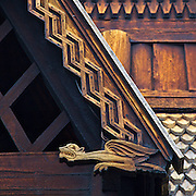 A stave church is a medieval wooden church with a post and beam construction related to timber framing.  All of the surviving stave churches except one are found in Norway, but related church types were once common all over northwestern Europe. This is detail from the Stave Church from Gol now found in the Folk Museum in Oslo, Norway.