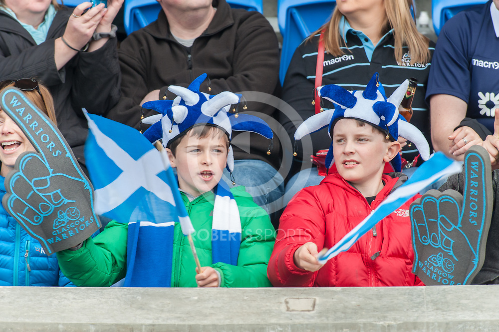 Young Scotland fans. Action from the IRB Emirates Airline Glasgow 7s at Scotstoun in Glasgow. 3 May 2014. (c) Paul J Roberts / Sportpix.org.uk