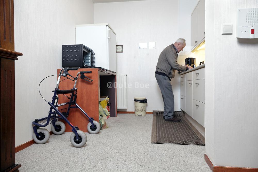 senior man preparing food in kitchen