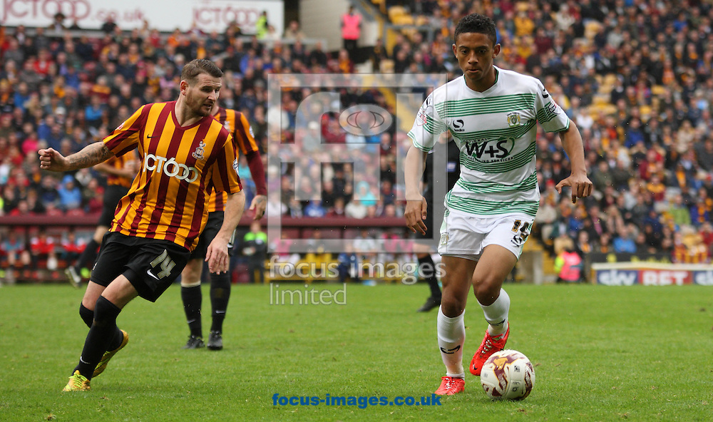 Mark Yates (L) of Bradford City tackles Nathan Ralph (R) of Yeovil Town during the Sky Bet League 1 match at the Coral Windows Stadium, Bradford<br /> Picture by Stephen Gaunt/Focus Images Ltd +447904 833202<br /> 06/09/2014
