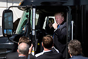 President Donald Trump sits in the cab of an 18-wheeler truck as he greets truckers and trucking company CEOs at the White House.