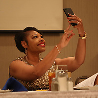 Recipient of the S.L. Ratliff Education Award, Pamela Traylor, takes a selfie Saturday evening at the Mr. Walter Standfield Freedom Fund Banquet hosted by Lee County/Tupelo NAACP Branch