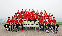 DINARD, FRANCE - Tuesday, June 7, 2016: Wales players line up for a team group photograph at the Novotel Thalasso Dinard ahead of the start of the UEFA Euro 2016 tournament. Back row L-R: Ashley 'Jazz' Richards, Emyr Huws, Paul Dummett, James Chester, Simon Church, George Williams, Jonathan Williams, David Vaughan. Middle row L-R: Andy King, James Collins, goalkeeper Daniel Ward, goalkeeper Wayne Hennessey, goalkeeper Owain Fon Williams, Sam Vokes, David Edwards, Ben Davies, David Cotterill. Front row L-R: Neil Taylor, Hal Robson-Kanu, Joe Ledley, Gareth Bale, captain Ashley Williams, Aaron Ramsey, Joe Allen. (Pic by David Rawcliffe/Propaganda)
