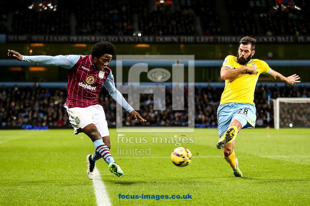 Carlos Sanchez of Aston Villa (left)  crosses during the Barclays Premier League match at Villa Park, Birmingham<br /> Picture by Andy Kearns/Focus Images Ltd 0781 864 4264<br /> 01/01/2015