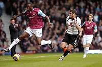 Photo: Leigh Quinnell.<br /> West Ham United v Fulham. The Barclays Premiership. 13/01/2007. West Hams Carlton Cole gets away from Fulhams Frank Queudrue.