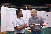 18208Student Reasearch & Creativity Activity Fair Spring 2007..David Dominguese,MS,ATC & Christina Hare,ATC shows her research on the Validity of Orthopedic test for the shoulder