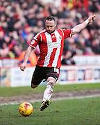 Ben Davies crosses during the Sky Bet League 1 match between Sheffield Utd and Swindon Town at Bramall Lane, Sheffield, England on 31 January 2015. Photo by David Charbit.