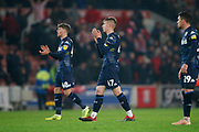 Disappointed Leeds United midfielder Jordan Stevens (48)  and Leeds United forward Jack Clarke (47) applaud the fans at full time during the EFL Sky Bet Championship match between Stoke City and Leeds United at the Bet365 Stadium, Stoke-on-Trent, England on 19 January 2019.