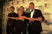 Denise van Outen and the Olympic coxless four. BAFTA Television Awards, sponsored by the Radio Times, Grosvenor House. London. 13 May 2001. © Copyright Photograph by Dafydd Jones 66 Stockwell Park Rd. London SW9 0DA Tel 020 7733 0108 www.dafjones.com