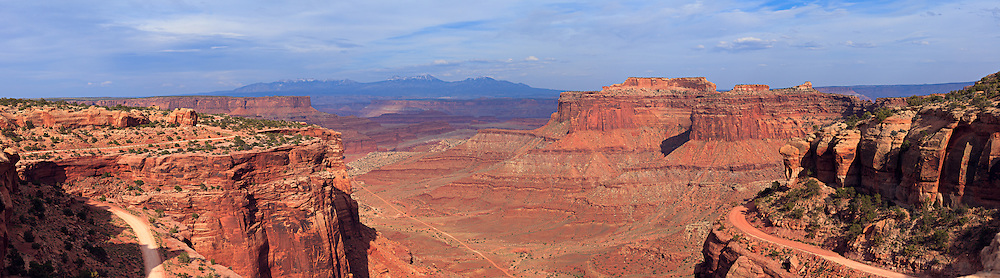 Panoramic view of Shafer Canyon and Shafer Trail Road near the Canyonlands National Park visitor center. The LaSal Mountains are visible in the background.