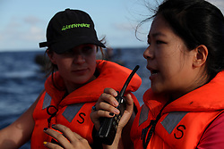 INDIAN OCEAN 28APR13 - Translator Lizzy Chen Ling-Chen of Taiwan and South African campaigner Dianne McAlpine (L) communicate via a radio with the Taiwan-registered Chin Horng No 3 and the Panama-registered reefer vessel Tuna Queen.<br /> <br /> <br /> <br /> The Greenpeace ship Esperanza is on patrol documenting fishing activities in the Indian Ocean.<br /> <br /> <br /> <br /> jre/Photo by Jiri Rezac / Greenpeace